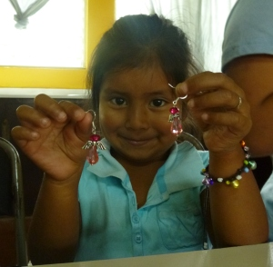 One client's young daughter proudly shows off her mother's new products!
