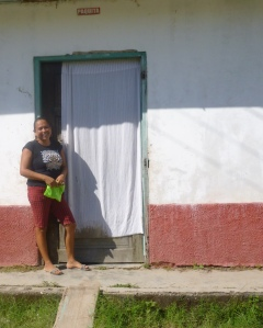 Oneida stands outside her home where she hopes to one day start a family.