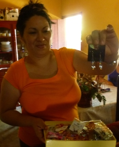 Blanca shows off earrings and other jewelry that she makes from home.