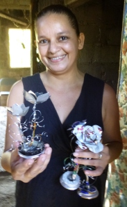 Filena makes these decorative flowers out of recycled aluminum cans to then sell for a profit.