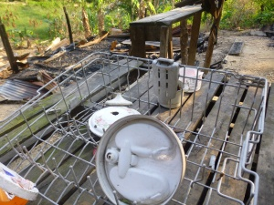A dish rack and scraps of wood and metal sheeting was all that was left of her home when we returned to the scene three weeks later.